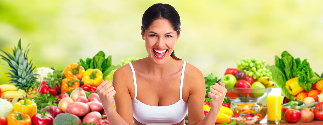 Beautiful young woman over fruits and vegetables diet background.